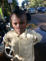 Kevin Johanna, in maart een beginnend straatkind nu een ijverig leerling, Kiandutu, Thika, Kenia, family empowerment, education, Circle4life