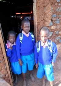 School uniforms, shoes, school bags, excersize books, pencils... they got it all. Peter, Veronica and Kaloki are very happy to return to school