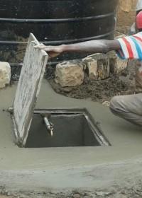 De put is klaar, de kraan aangesloten en de deksel gemonteerd, Circle4life Kenya, education, family empowerment