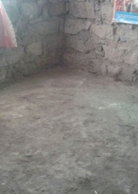 Een van de slaapkamers van het huis van de moeder van Felistar, Kenia